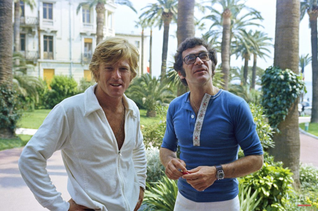 "American Actor Robert Redford and Director Sydney Pollack at the Cannes Film Festival before the presentation of their film ""Jeremiah Johnson"" on May 6, 1972. (AP Photo/Jean Jacques Levy)"