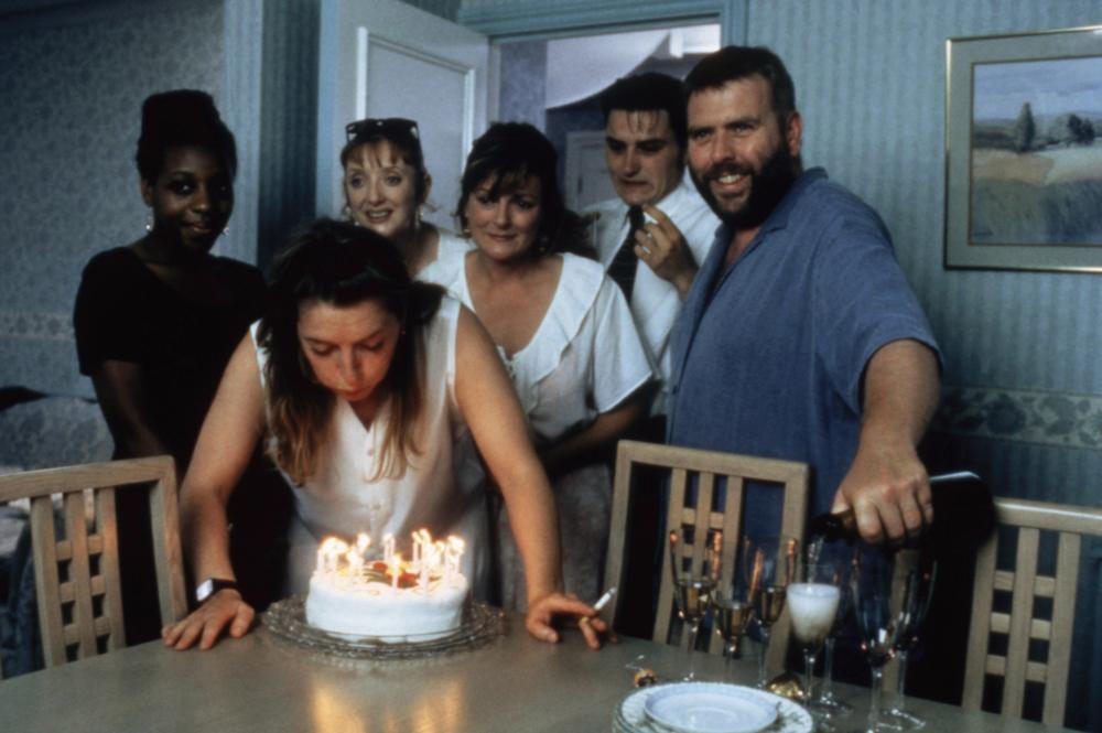 SECRETS & LIES, Claire Rushbrook (blowing out candles), Marianne Jean-Baptiste, Elizabeth Berrington, Brenda Blethyn, Lee Ross, Timothy Spall, 1996, (c) October Films