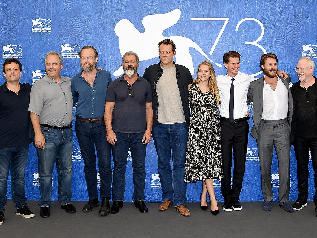 VENICE, ITALY - SEPTEMBER 04:  (L-R) Producer Bill Mechanic (2nd L), actor Hugo Weaving, director Mel Gibson, actor Vince Vaughn, actress Teresa Palmer, actor Andrew Garfield, actor Luke Bracey and guest attend a photocall for 'Hacksaw Ridge' during the 73rd Venice Film Festival at Palazzo del Casino on September 4, 2016 in Venice, Italy.  (Photo by Venturelli/WireImage)