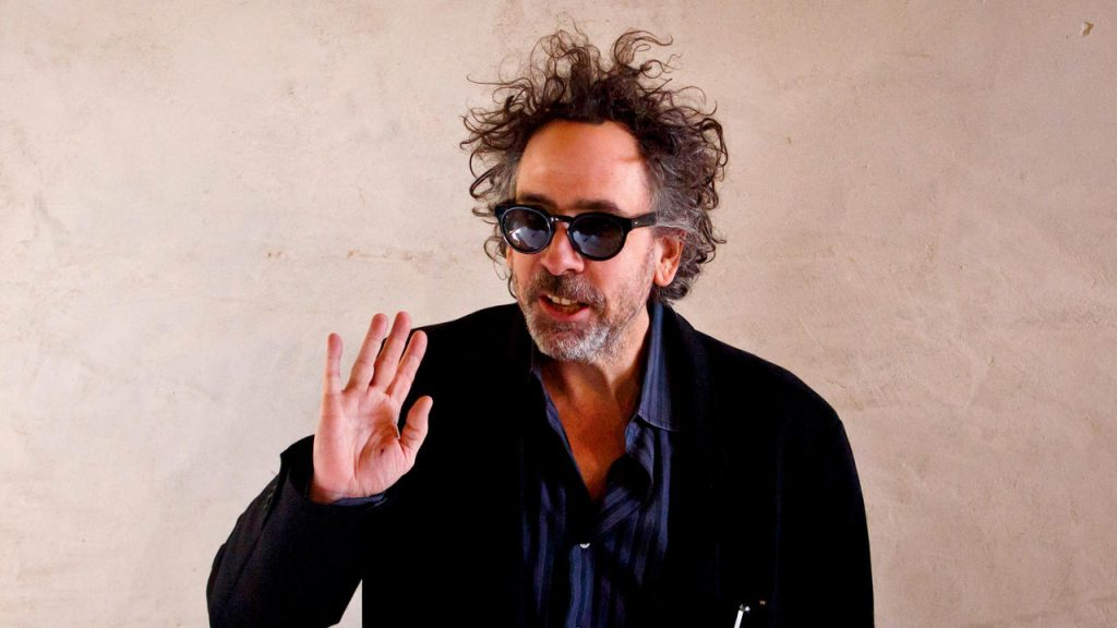PRAGUE, CZECH REPUBLIC - MARCH 27: Director Tim Burton waves at a press conference prior to a press preview of his exhibition 'The World of Tim Burton' on March 27, 2014 in Prague, Czech Republic. The exhibition, which runs until August 3, will feature 500 of Burton's drawings, paintings, photographs, sketchbooks, moving-image works, and sculptural installations. (Photo by Matej Divizna/Getty Images)